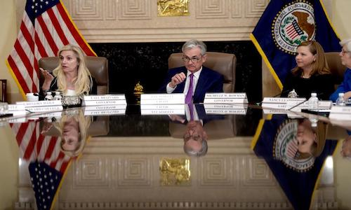 Photo of U.S. Federal Reserve Chair Jerome Powell (center) flanked by Federal Reserve Governors Lael Brainard (left) and Michelle Bowman (right) at an event in Washington, DC on Oct. 4, 2019.